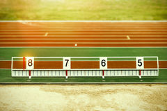Athletics long jump sand pit with marks Stock Photos