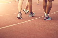 Athletics people walking exercise on the track field outdoor. Copy space Royalty Free Stock Photography