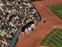 Athletics pitchers sit the the bullpen Royalty Free Stock Photos