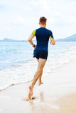 athletics Praia apta de Jogger Running On do atleta workout Esportes, fotografia de stock royalty free