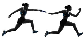 Athletics relay runners sprinters running runners isolated silho Royalty Free Stock Photography
