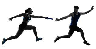 Athletics relay runners sprinters running runners isolated silho. Athletics relay runners sprinters running runners in silhouette isolated on white background Stock Photo