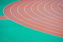 Athletics running track. Red curve athletics running track royalty free stock photos