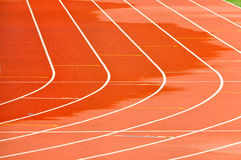 Athletics Running Track. Details of a wet athletics running track Royalty Free Stock Photos