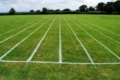 Athletics running track on grass Royalty Free Stock Photo