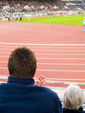 Athletics Spectator. Spectator watching athletics on the Olympic Stadium in Helsinki Stock Photos