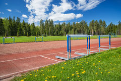 Athletics sport field on sunny summer day Stock Photos