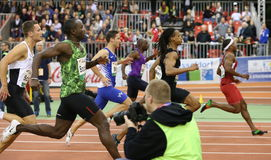 Athletics. Sprinters participating in the PSD Bank Indoor Athletics Meeting in Düsseldorf Germany. Here the runners cross the finishing line Stock Image
