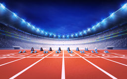 Athletics stadium with race track with starting blocks front view Royalty Free Stock Image