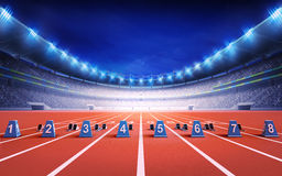 Athletics stadium with race track with starting blocks Royalty Free Stock Images
