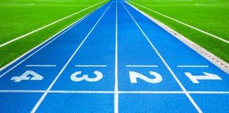 Athletics stadium running track blue lines marks. Royalty Free Stock Photography