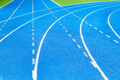 Athletics stadium running track blue lines marks. Royalty Free Stock Photo