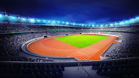 Athletics stadium with track and grass field at corner view Royalty Free Stock Photography