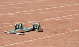 Athletics starting block. On a stadium tartan Royalty Free Stock Photography