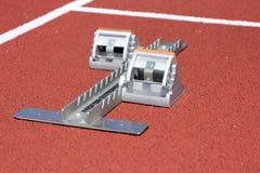 Athletics starting blocks on race red track.  Royalty Free Stock Photo