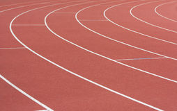 Athletics track. With its lane, white lines and turn stock images
