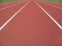 Athletics track. Lines leading forward into the distance on a athlectics track Royalty Free Stock Images