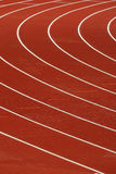 Athletics track. Red Track and field venue with white lines Stock Photos