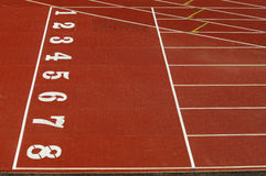 Athletics track. Red Track and field venue with white lines and numbers Royalty Free Stock Images