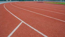 Athletics Track Lane. Made with orange rubber Stock Image