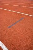 Athletics Track Lane. Made with orange rubber Stock Photo