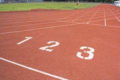Athletics Track Lane. Made with orange rubber Stock Photos
