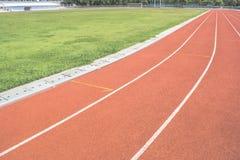 Athletics Track Lane. Made with orange rubber Royalty Free Stock Photo