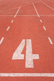 Athletics track lane number four Royalty Free Stock Photography