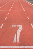 Athletics track lane number seven Royalty Free Stock Photo