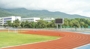 Athletics Track Lane. Runners racetrack   surrounded by mountain in university Stock Images