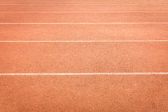 Athletics track lanes with white line Royalty Free Stock Photos