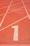 Athletics track number one. The beginning of the athletics track. the start of the athletics Royalty Free Stock Photos