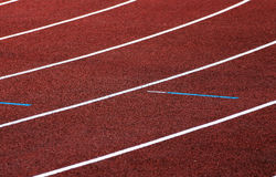 Athletics track. Turn the race an athletics track with red tartan surface royalty free stock photo
