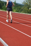 Athletics training. Man training on athletics running track Stock Image
