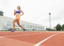 Athletics woman Track Athlete Running On Track. She is on stadium stock photography