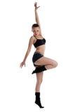 Athletische junge Frau, die im Tanzsportkostüm aufwirft Stockbild