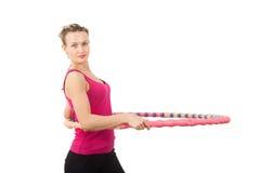 Athletische junge Frau mit Kreis Stockfoto