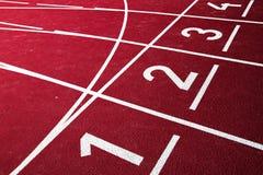 Athletische laufende Spur stockfotografie
