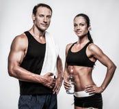 Athletischer Mann und Frau Stockbilder