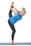 Athletisches Mädchen auf gymnastischer Matte Stockfotos
