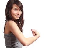 Athletisches Mädchen mit dem starken Arm Stockfotos