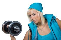 Athletisches Mädchen mit Dummköpfen Stockbild