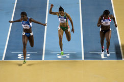Athletism. Athletes are competing during 60m race in IAAF World Indoor Championship 2012, Istanbul, on March 10, 2012 Stock Photo