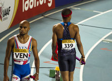 Athletism. Venezuelan and athlete from USA are in same scene before 400m in IAAF World Indoor Championship 2012, Istanbul, on March 10, 2012 Stock Images