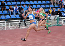 Athlets compete in 100 meters race Stock Image