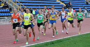 Athlets compete in 1500 meters race Stock Photos