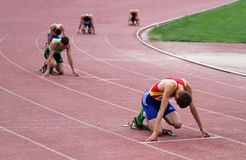 Athlets compete in 400 meters race Royalty Free Stock Photography