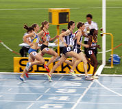 Athlets compete in the 800 meters race Stock Photos