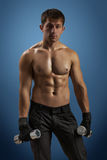 An athlette man with dumbbells Stock Photography