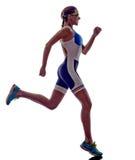 Athlète courant de coureur d'ironman de triathlon de femme Photo libre de droits